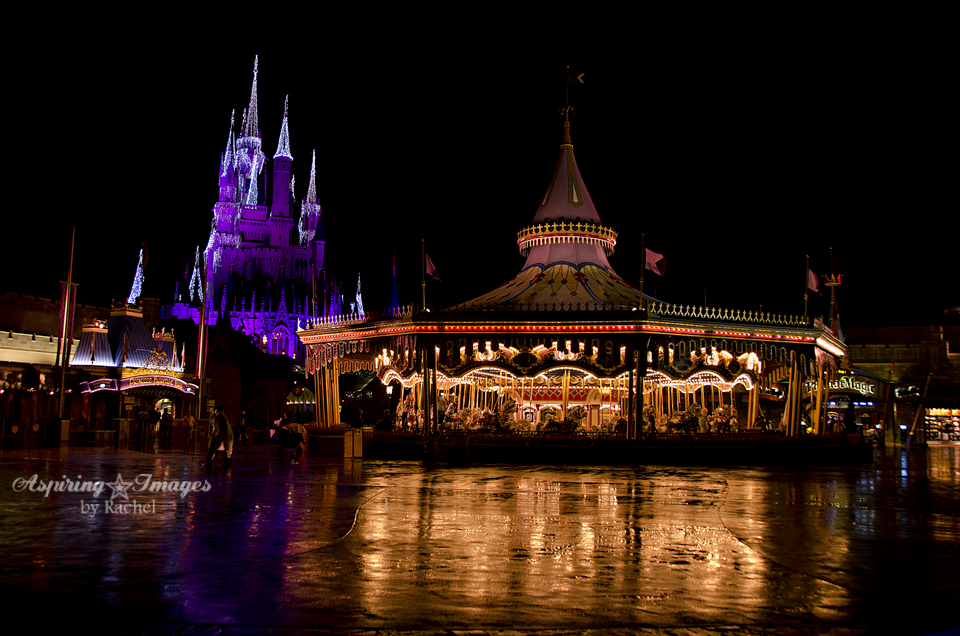 Magic Kingdom Carousel and Castle At Night In Rain by Aspiring Images by Rachel