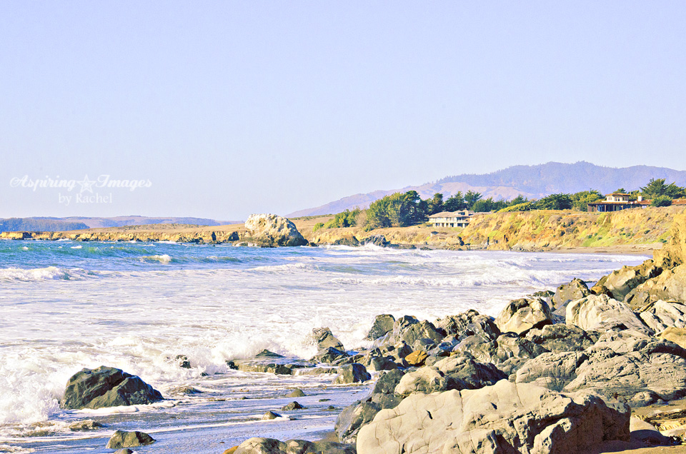 California Beach Alcove- Rocks And House by Aspiring Images by Rachel