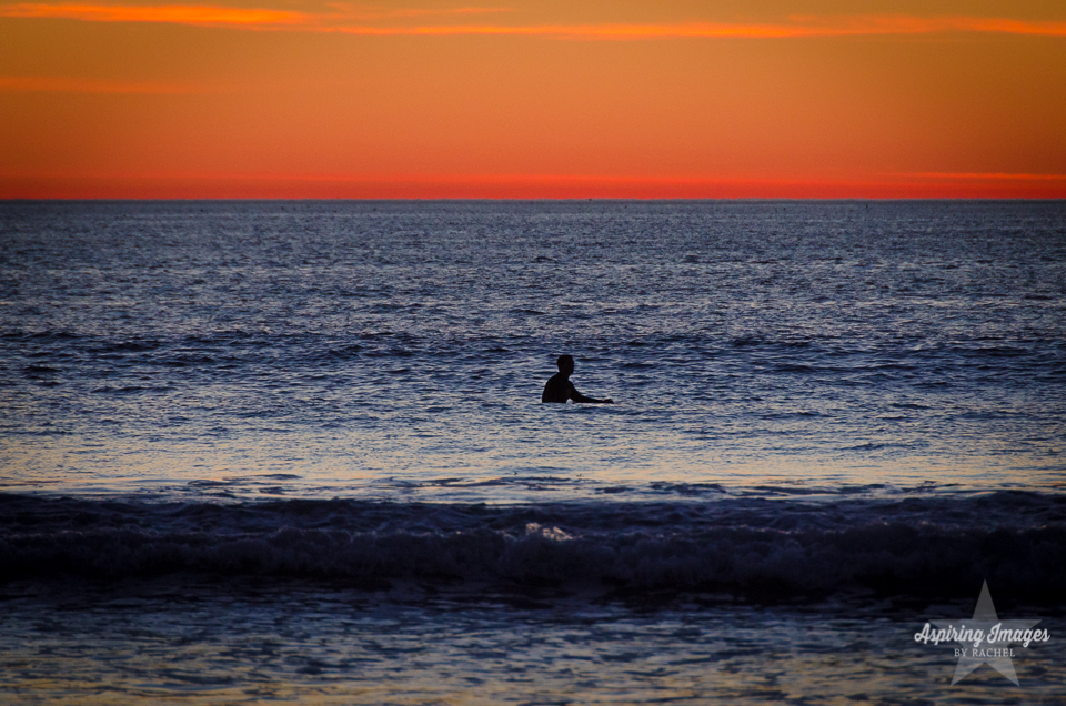 AspiringImagesbyRachel-California-SanDiego-SurferInWater-BlueOrangeSunset